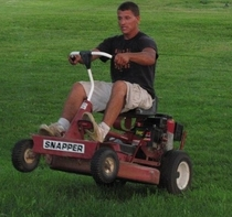 My buddy Nick has been working on race cars since he was a child This is him after he fine tuned his lawn mower