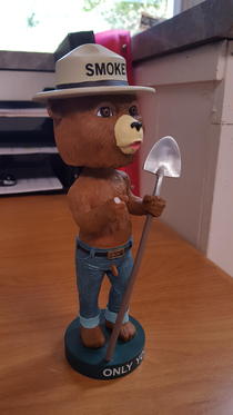 My co-worker broke the finger off of my Smokey bobblehead but we were able to fix it