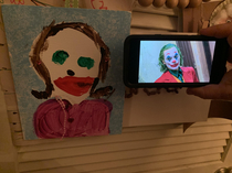 My cousin has green eyes and likes to wear lipstick and her  year old daughter wanted to draw a nice picture of her