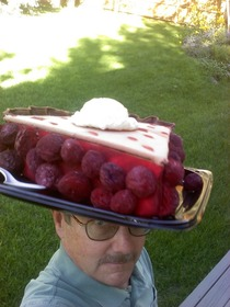 My dad loves ridiculous hats For his churchs cherry pie sale fundraiser he decided to make one of his own