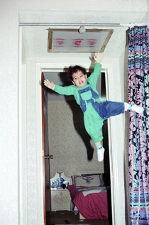 My dad thought -year-old me was strong enough to hang from the curtain rod while he takes a picture