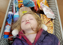 My daughter fell asleep in the cart at the grocery store last night and she totally looked like a fallen viking warrior being sent out to sea