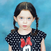 My daughters school picture Shes a bit too obsessed with Wednesday Addams