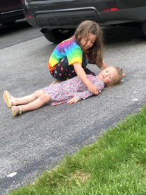 My daughters wanted to play with chalk outside I came out to them setting up a fake crime scene