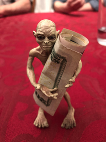 My family and I use this Gollum toy to hold the money when we play cards