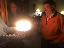 My family celebrated my Dads th birthday today Im away at school and my brother sent me this pic Apparently  years of candles is enough to give birth to a protostar