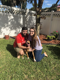 My fiance and I wanted a nice picture of us with our dog for Christmas he sneezed