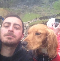My friend climbed a mountain and took a selfie was photo bombed by girlfriend taking selfie