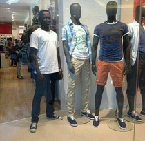 My friend decided to pose with the mannequins at the mall
