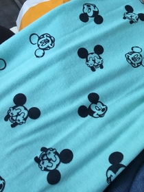 My girlfriend bought this Mickey Mouse scarf for our baby She didnt look close enough at what gesture hes making
