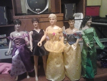 My little sister made me help her put her One Direction dolls in dresses