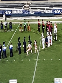 My local university had a marching band competition and one of the colorguard uniforms made them look naked I caught a pic right as it looks like hes about to take a dump Potato quality