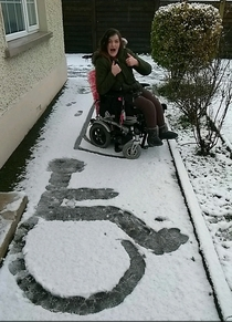 My sister proudly showing off her first snow angel