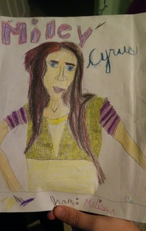 My sisters attempt at drawing Miley Cyrus somehow ended up as Nicholas Cage