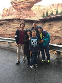 My son was asked to take a picture of a nice Asian family at Disneylandhe did not understand