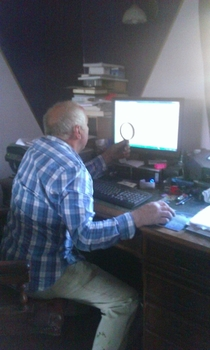 My step dad looking at maps on the pc I did eventually tell him you could zoom in