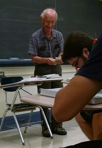 My teachers face after he made my class pay  each for a book that only cost