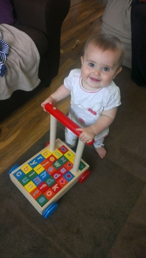 My Wife was at work and I thought it would be nice to send her this pic of our daughter using her baby walker for the first time She immediately forwarded it to her Mum and SisterThen noticed something wrong