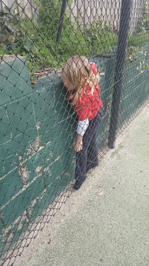 My  year old sister getting stuck in between a wall and a fence