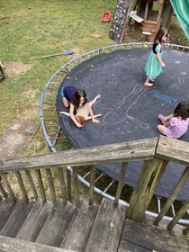 Not sure how I should feel about my daughters drawing chalk outlines of each other