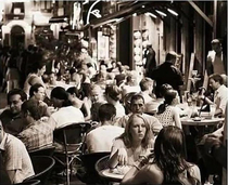 Old photo of people eating at a crowded restaurant  BC Before Corona