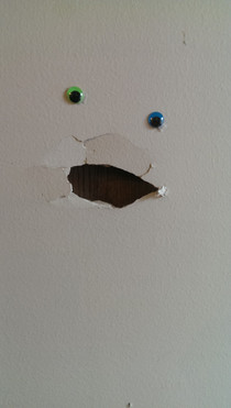 One of my employees accidentally smashed a hole in our wall I decided to improve it