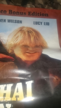 Owen Wilson looks like Annoying Orange on this bent movie poster