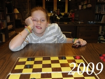 Pic #1 - Every Thanksgiving my little cousin challenges me to a game of checkers Ive been documenting her defeat for the past eight years