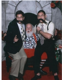 Pic #1 - Every year my friends visit the same Santa at the mall and take a photo with him Here is their latest