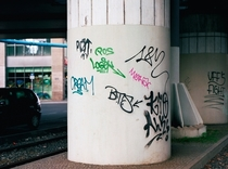 Pic #1 - Guy paints over graffiti with a more legible font