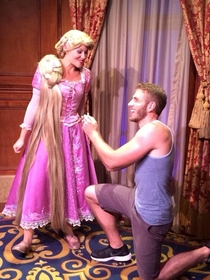 Pic #1 - Guy proposes to various Disney characters at Disney World