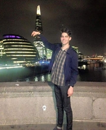 Pic #1 - My friend tried to hold some famous landmarks in his fingers