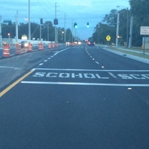 Pic #1 - Road workers in front of my high school misspelled the word school