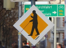 Pic #1 - Street signs warning of technically blind pedestrians