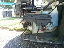 Pic #2 - My friend mounted a BB gun in his front bumper that he can fire while driving