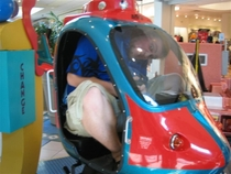 Pic #4 - Over the past few years I have been cramming myself into small childrens rides at the mall