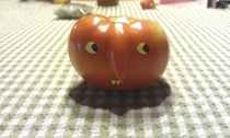 Pic #4 - We had a tomato with a strange growth My mom used a sticky note to make it into a nose