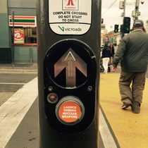 Pic #4 - Workmate put these stickers on crossing buttons around Melbourne