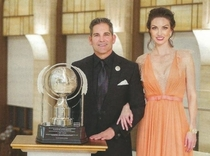 Pic #7 - All of these dumb-asses have each given Scientology  million so they could pose for these stupid pictures next to those stupid trophies