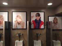 Pictures above the urinals at a bar