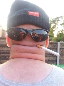 Possibly the most creative use of a hat sunglasses a cigarette and the back of someones head youll see all day