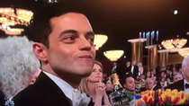 Rami Malek always looks like hes trying to eat chips as quietly as possible