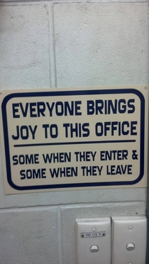 Recently got moved to a new office this sign is glued to wall