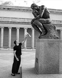 Robin Williams offering a toilet roll to  The Thinker