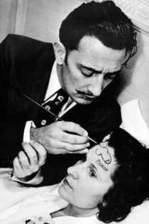 Salvador Dali paints a dick on a ladys forehead