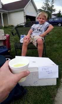 Saw this kids lemonade stand while walking Hes going places