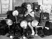 Shirley Temple with her trophies from all the paparazzi she killed