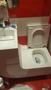Sink attached to the toilet forming a perfect slide