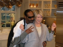 Snoop photographed flashing gang signs with a convicted felon