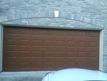 So my parents wanted their garage door to look wooden but I think it looks more like a giant Hersheys bar